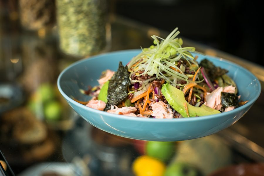 Sushi Salad with Salmon Confit | Shredded papaya, carrot, asparagus, avacado on a bed of brown rice with wasabi dressing.