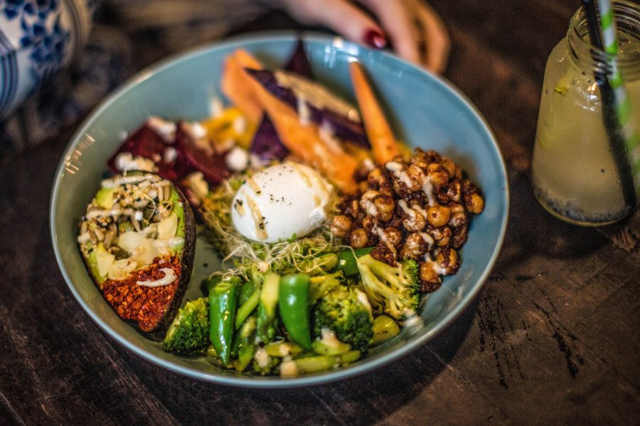 Redemption Bowl | roasted veggies, nuts, seeds, poached eggs finished with a tahini drizzle