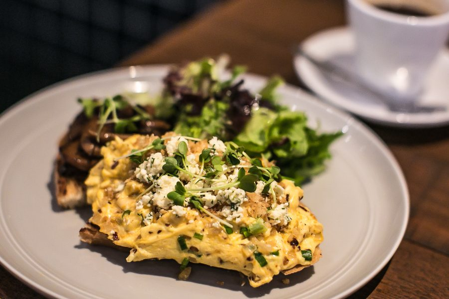 Chili infused creamy scrambled eggs, wild mushrooms with aged balsamic on homemade pepita toast